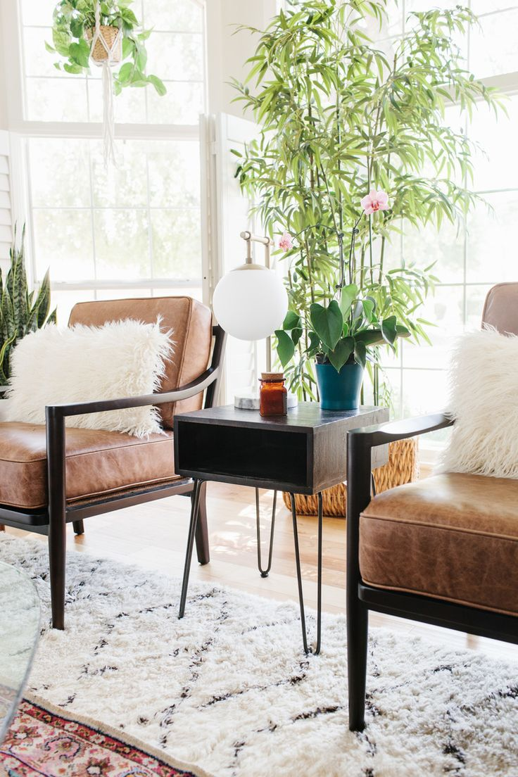 Eiffel chair living room - Mid Century Style Leather Chairs Paired With A Hair Pin Side Table And Tons Of