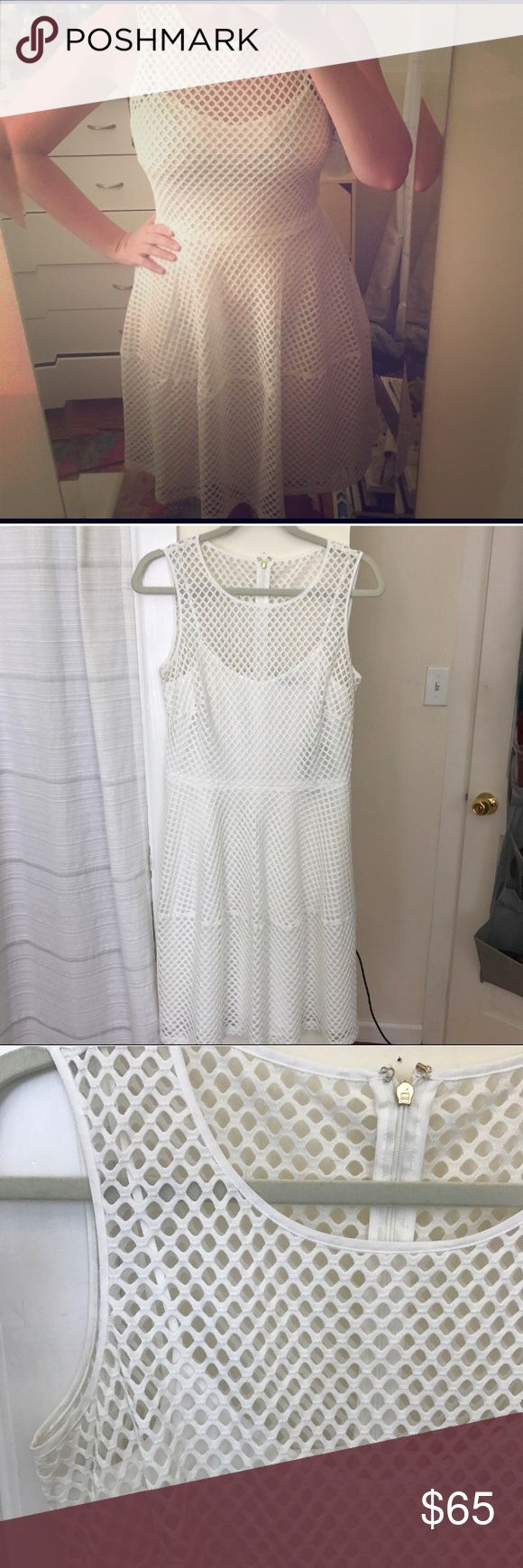 Tommy Hilfiger Mesh A-like Dress Solid white dress with mesh/netted overlay. Size 8. New with tags however purchased from sample sale in NYC so no official tags or washing instructions tag. Sample means it may have never gone into production too -so who knows this may be a one of a kind 😍! Tommy Hilfiger Dresses Midi