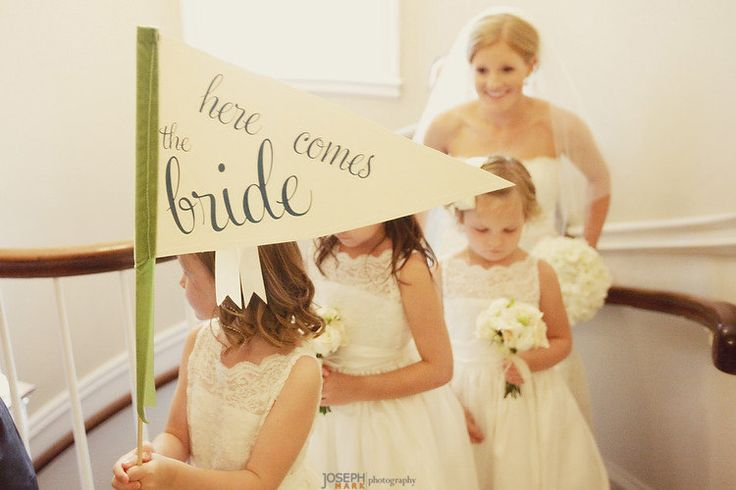 Here Comes The Bride Sign - Large Pennant Flag Wedding Sign For Your Flower Girl. $48,00, via Etsy.