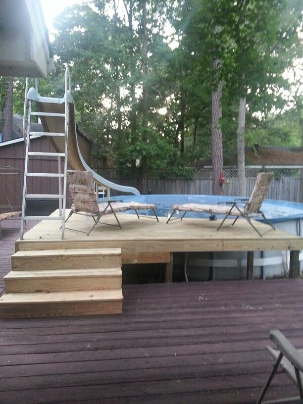 pool deck with slide above ground