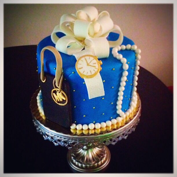 Stylish Birthday Cake with pearls, women's watch and Michael Kors handbag.