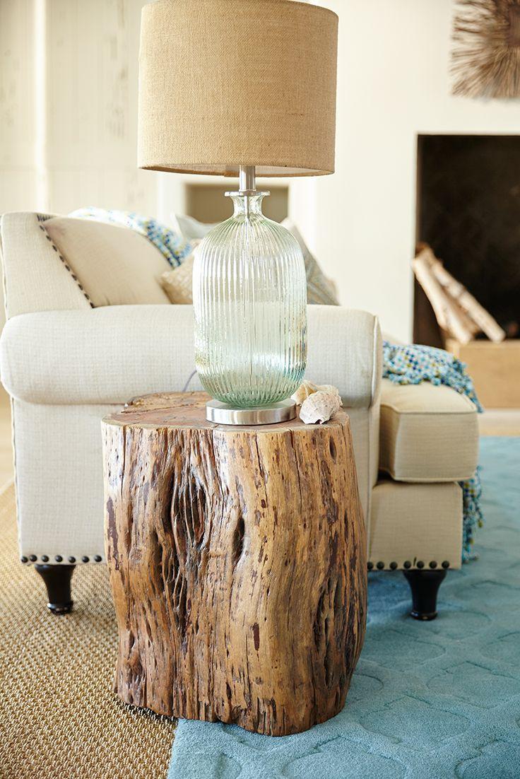 Kudos to you for branching out with Pier 1's Maram Natural Tree Stump Accent Table. Hewn from the trunk of an acacia tree, our solid wood table showcases the beauty of its polished natural grain. Contemporary yet rustic, each handcrafted table has one-of-a-kind appeal, thanks to the interesting knots and fissures unique to each piece.