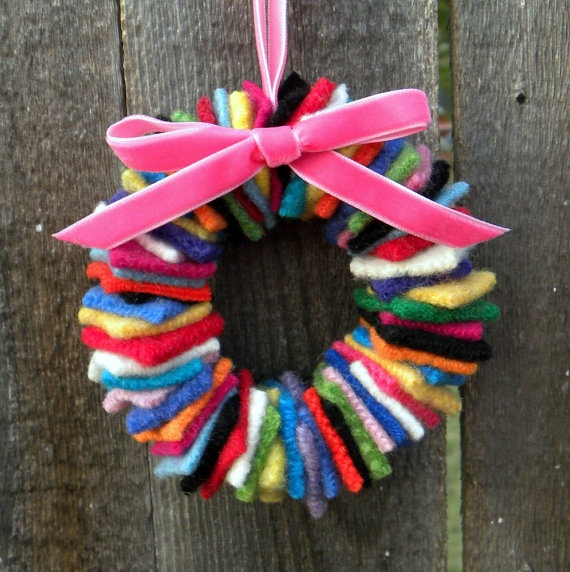 this could be a cute student made wreath (recycled wool sweaters or felt... whatever's handy)