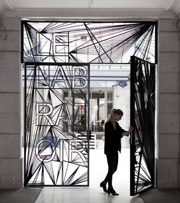 Typographic Door Entrance - Amazing juxtaposition of the humanistic, geometric, san serif, custom typeface and the radiating line patterns rendered in the metal.
