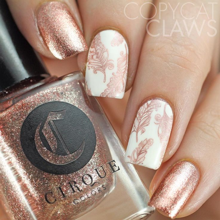 I'm so in love with the rose gold trend. This is @cirquecolors Halcyon with stamping on white with @essiepolish Penny Talk. The feathers from @bundlemonster BM-S308 stamped so amazing!