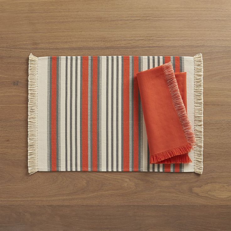 Aspen Stripe Orange Placemat and Aspen Orange Napkin    Crate and Barrel