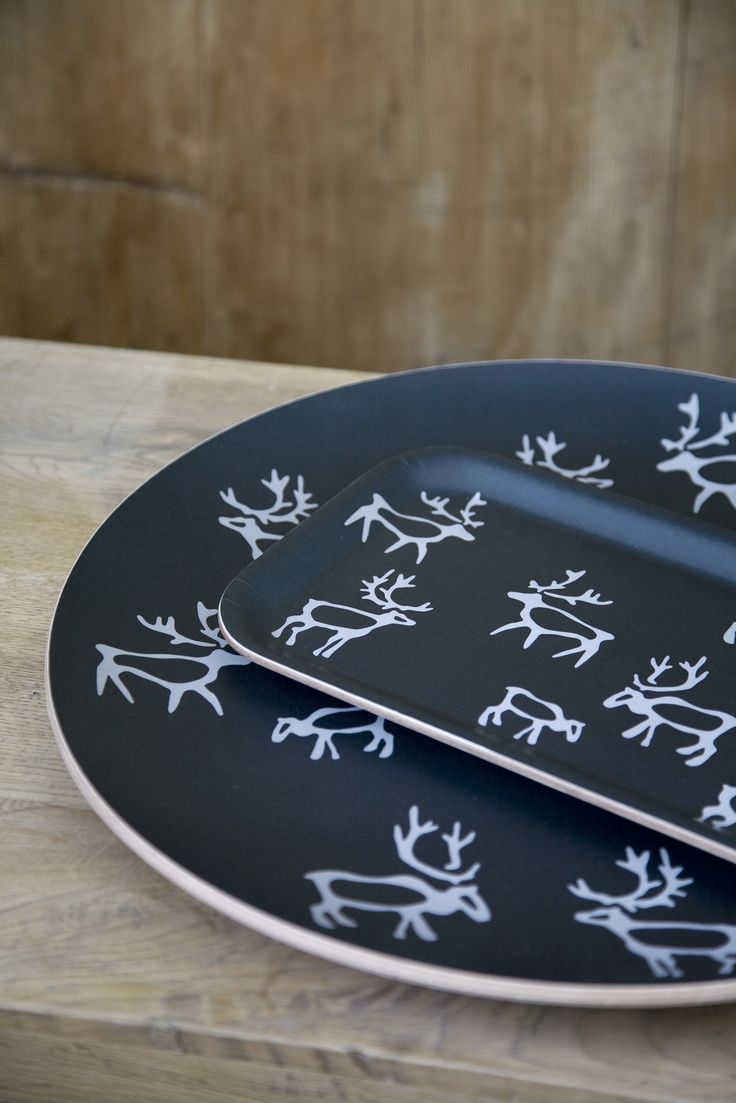 Saaga Tray | Pentik |  The products of Saaga series bring a hint of northern touch to your table setting. Designed by Minna Niskakangas, the reindeer pattern of Saaga has been inspired by northern rock paintings and warm gray shades of deadwood.