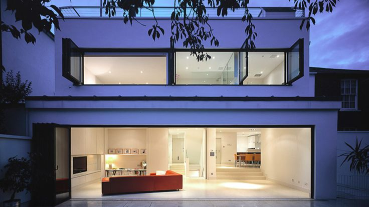 Modern extension to an 1970's house in Putney.  Horizontal windows on the first floor and folding glass screen on the ground floor open up the entire house to the landscape.