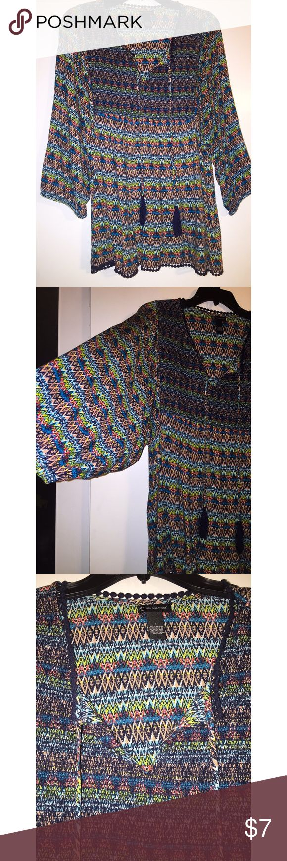 New Directions Smock Top This Aztec print top has vibrant colors and large sleeves with two hanging tassels. Worn once. Excellent condition! new directions Tops Blouses