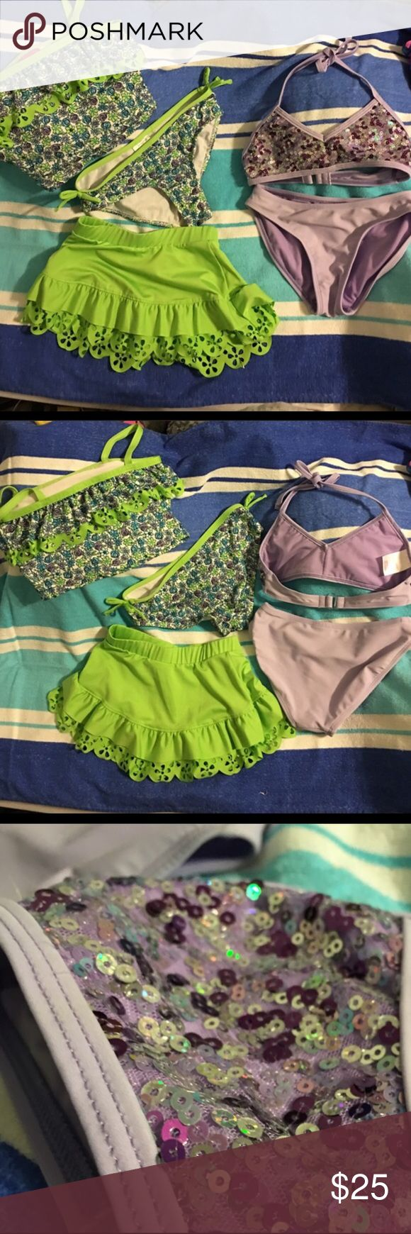 Girls 6/6x swim lot bikini, tankini, skirt cover Suit #1 lavender Xhilaration bikini with purple and silver sequins. Ties behind neck, plastic hook in back. Includes matching bottom. In great preowned condition. #2 pull on style tankini in white, lime, blue, and lavender flower design with spaghetti straps by Penny M. Matching bottom with decorative bows on sides and lime green skirt coverup with flower cut outs on ruffles. Some cutouts on the top are torn. It is not noticeable and mostly…