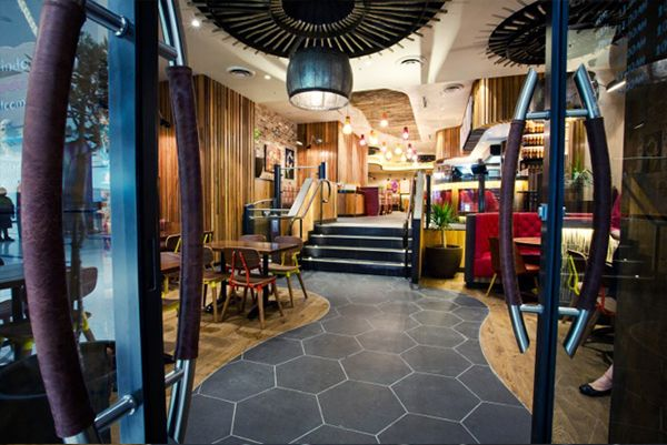 Completed supply & install at Nandos NSW #Customised stone for floors and walls by Stone101 Melbourne. #Bluestone hexagonal available at Stone101