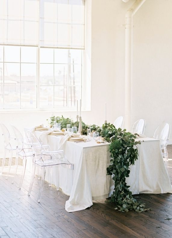 All-white tablescape set off with a leafy table runner