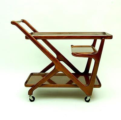 Botterweg Auctions Amsterdam > Wooden tea-trolley on swinging wheels, with glass top and separate serving tray, design attributed to Cesare Lacca for Cassina/ Italy ca.1950