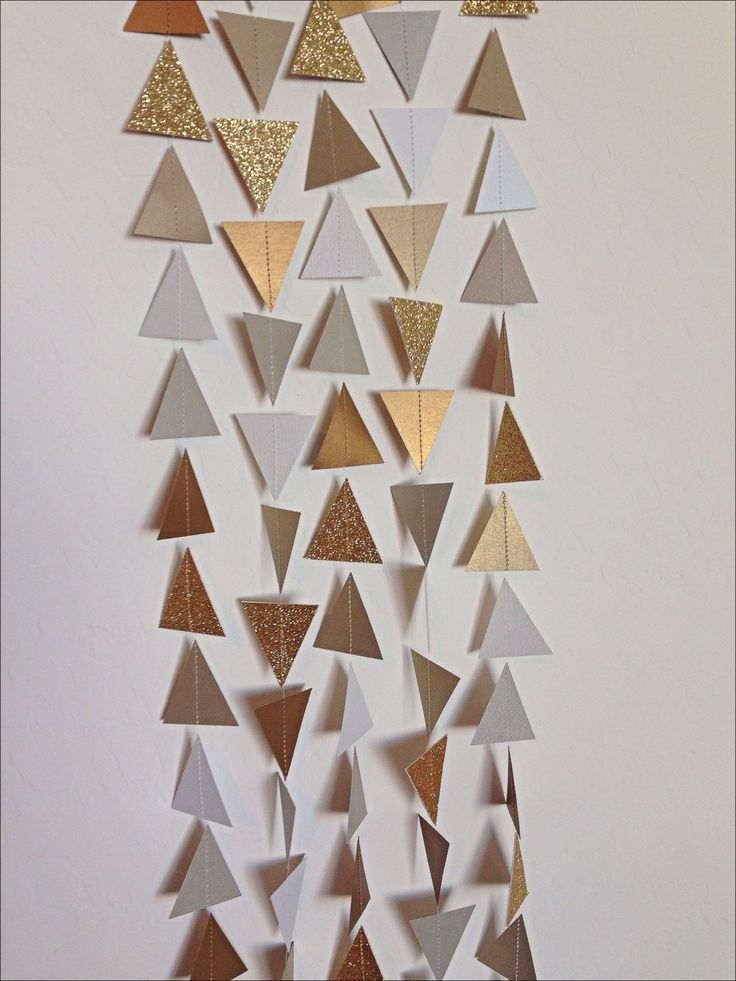 Gold Silver White Triangle Garland. Geometric Garland. Paper Backdrop. Baby Shower. Birthday Garland. Wedding Garland. Photo Prop. Tribal by LaCremeBoutique on Etsy https://www.etsy.com/listing/211475889/gold-silver-white-triangle-garland