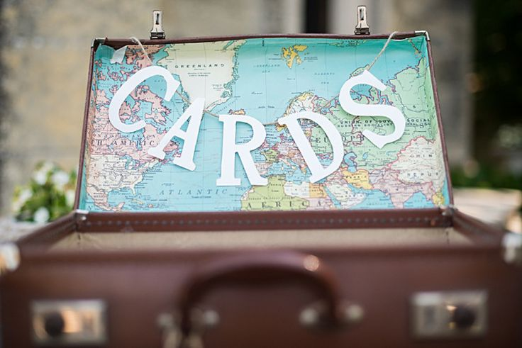 Vintage suitcase as card holder with a map of the world insert  | Photography by http://louiseadbyphoto.com/