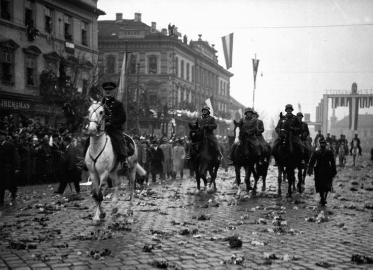 1938 Partition of Czechoslovakia - Admiral Miklos Horthy, the Fascist dictator of Hungary, riding triumphantly with his entourage through the streets of Kosice after its occupation by the Royal Hungarian Army.