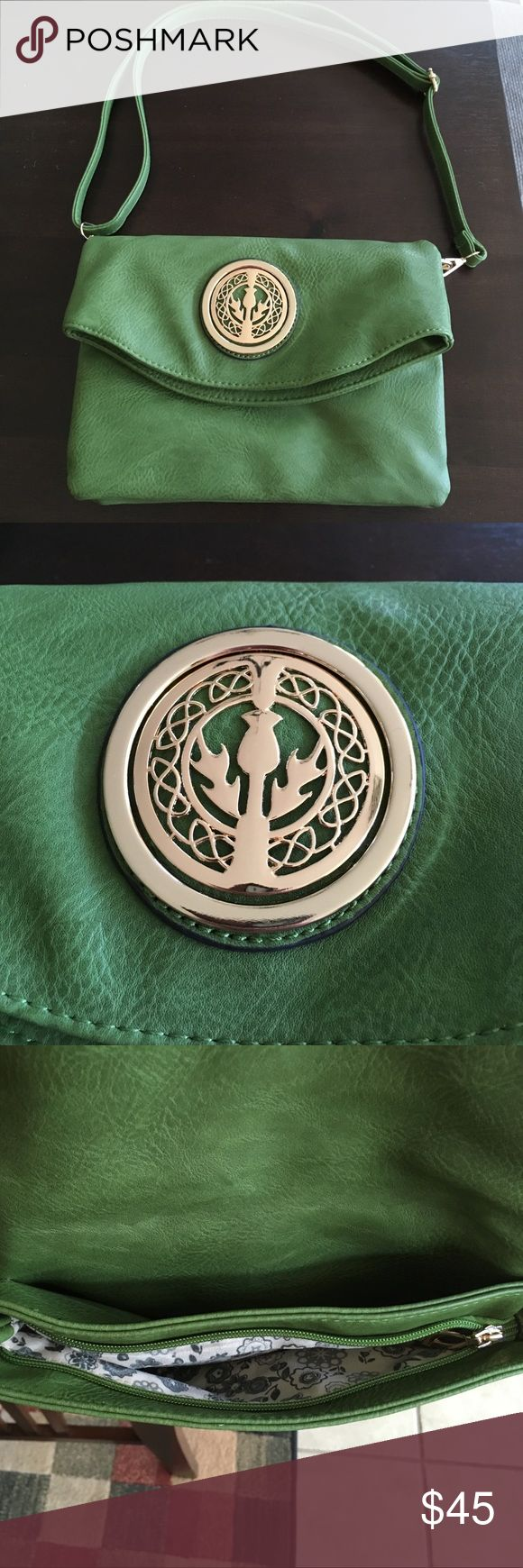New Beautiful Scottish Hunter Green Purse Bought in Scotland. Never used as was to be a gift. Scottish thistle emblem. Lots of storage as it has 4 different pockets/access. Secure with both zipper and snaps closures. Can be worn as a shoulder bag or cross body bag due to adjustable strap. Leather look and feel. Very unique. Bought in a boutique not a chain. Bags Shoulder Bags