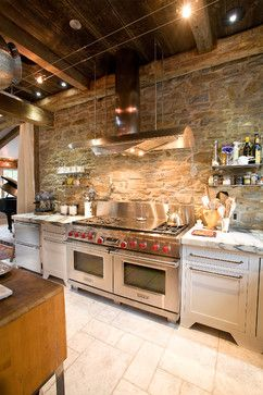 Exposed stone wall - Exposed wood ceiling - Stainless steel, marble, and whit cabinets - Jarrett Design, LLC