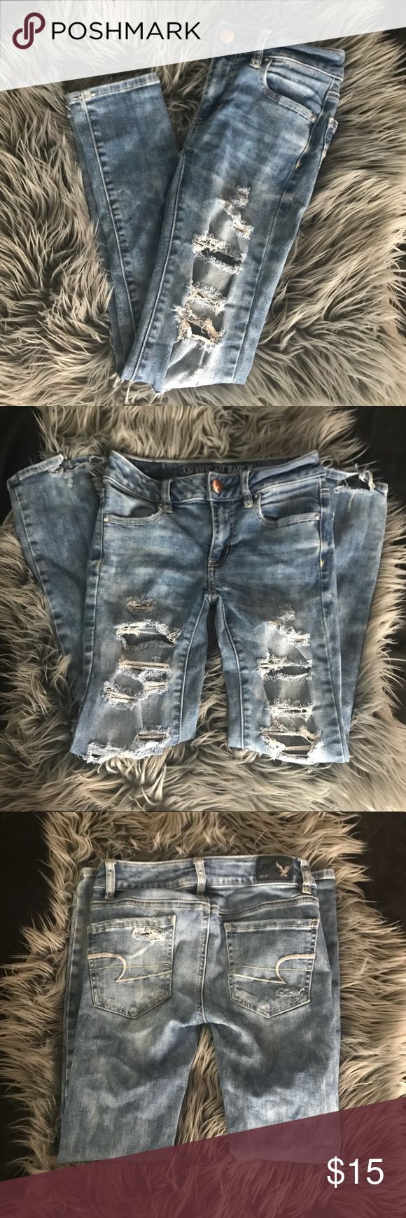 American Eagle Ripped Jeans Never worn and in perfect condition. 32 inches in length. Jegging ankle skinny fit jeans. The jeans have super stretchy material so they're always the perfect fit. Offers welcome but no trades. American Eagle Outfitters Jeans Skinny