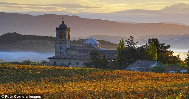 The sun sets over the monastery of Irache near Estella, just one of the stunning sights along the 500-mile Camino pilgrim trail in northern Spain. I want to do this!!
