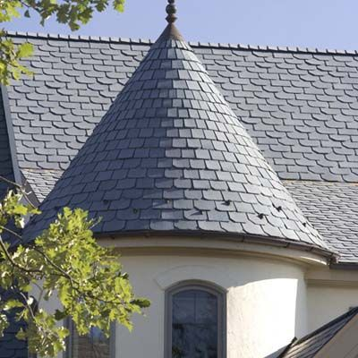 Recycled-Rubber Tile  Want a roofing material that's light on both your roof and your pocketbook, is friendly for the environment, and meets the toughest fire-resistance requirements? Have a look at EcoStar's recycled-rubber Majestic Slate Traditional tiles. Manufactured using a highly effective fire retardant and underlaid with a fire-resistant barrier, this assembly is one of only a few synthetic roofing materials to get UL's Class A fire rating. Expect to pay $6.50- $8.50 per sq ft