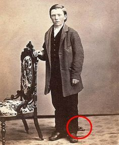 This boy is also dead, but that's not what he's here to demonstrate. We've established that Victorian people photographed their dead for posterity before holding any sort of funeral services for their loved ones, but what's interesting about this photo is the detail near his foot.