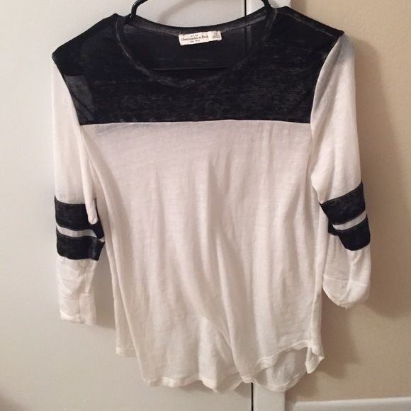 Black and white featherweight baseball tee Very light and thin baseball tee. Partially see through. Great to wear over leggings or skinny jeans. There is a little threading damage as shown in the picture but nothing too noticeable. Abercrombie & Fitch Tops Tees - Long Sleeve