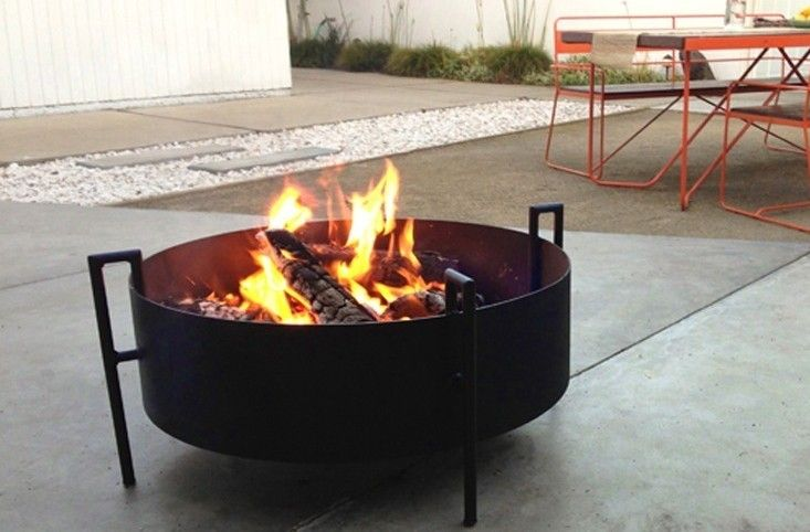 """Portable and yet """"built to last a lifetime,"""" a large steel Daze Fire Ring is 31 inches in diameter and has a thermal ceramic coating. It sits on three 14-inch-high legs and is $834 from Haskell."""