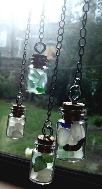 Tiny bottles of sea glass chips catching the sun