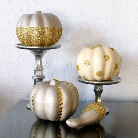 Dress up some dollar store pumpkins and gourds with spray paint and glitter & learn how to DIY your own faux mercury-glass pedestals!