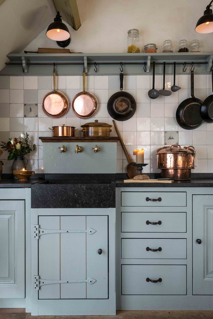 Sink in rustic kitchen with Dutch tiles ( friese witjes )