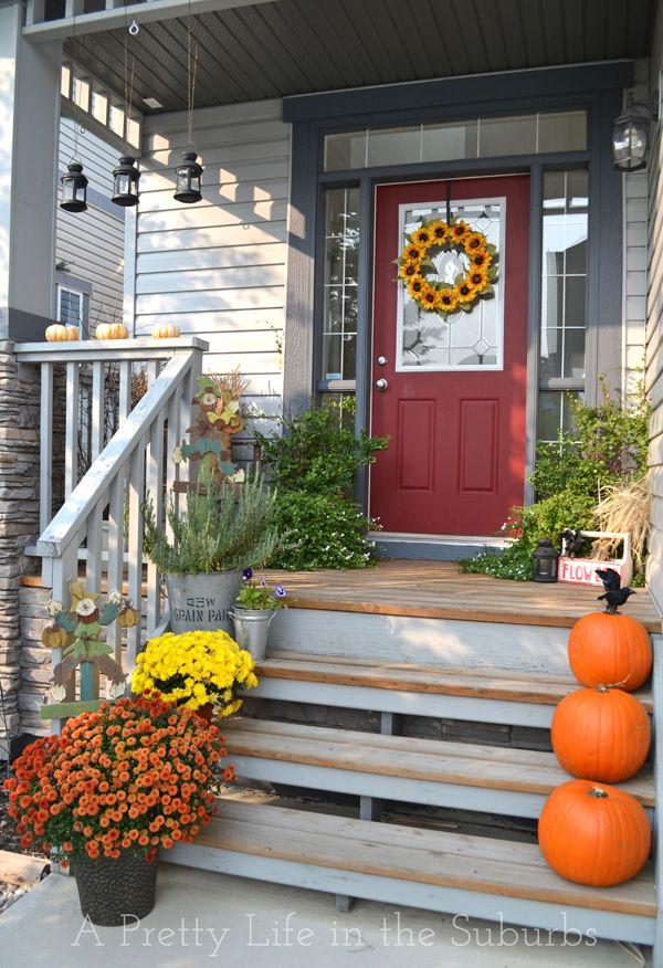 dark gray house with yellow door tan house white trim light blue