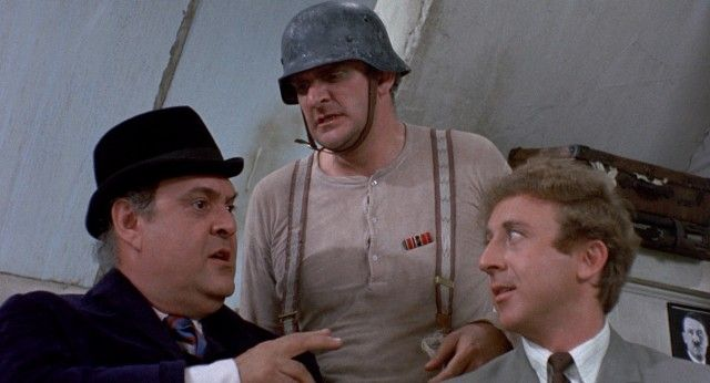 "Producers Bialystock and Bloom (Zero Mostel and Gene Wilder) secure the rights to ""Springtime for Hitler"" by patronizing its passionate writer Franz Liebkind (Kenneth Mars): http://www.dvdizzy.com/theproducers.html"