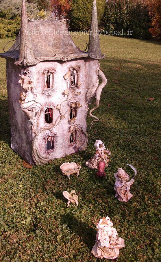 semi-creepy inhabitants --but I LOVE the house! paper mache