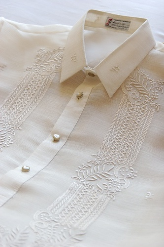 Barong Tagalog - traditional men's shirt, made of coconut fibers. This is still worn at weddings and special events. A simple cotton version of this is often worn by business men instead of a western button down collar shirt. - Philippines