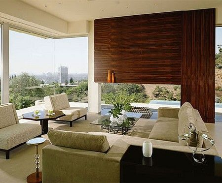 This image of a lounge room in a home shows how scale can be used effectively in design. Large, plate glass windows gives people a great sense of scale and openness while present in the room.