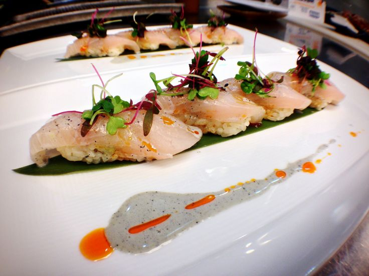 Out in Las Vegas, Chef John created a sushi dish with Shizuoka kanpachi, black sesame creme, chili oil, and intense micro free mix.