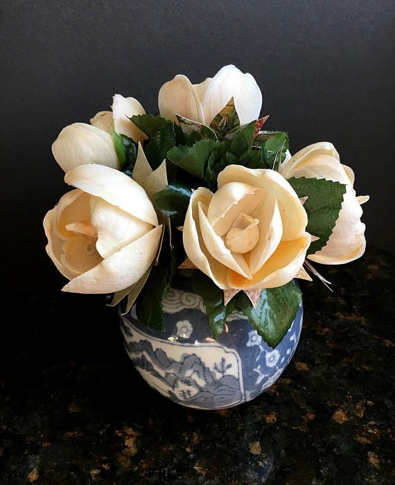 Sea shell flower arrangement - 6 unique, life-like sea shell flowers nestled in a blue and white ceramic vase and adorned with greenery