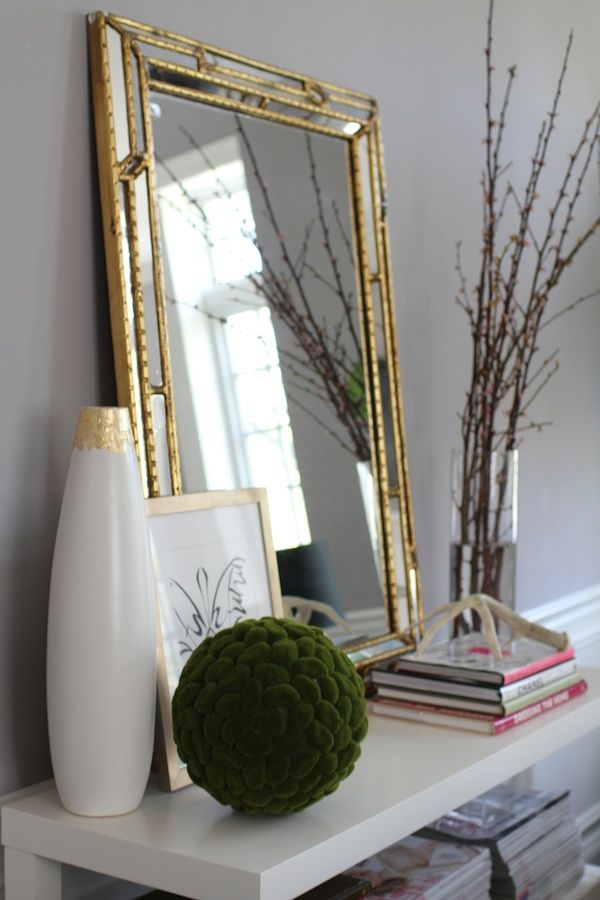 gold mirror, white table