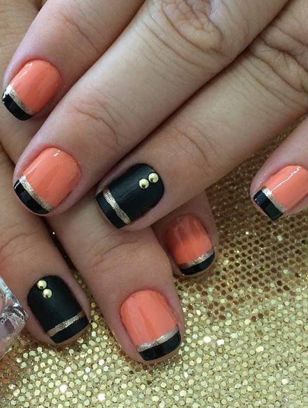 Black and melon nail polish with accents of silver glitter polish and beads. Make your nails stand out with contrasting colors and embellishments on top for effect.