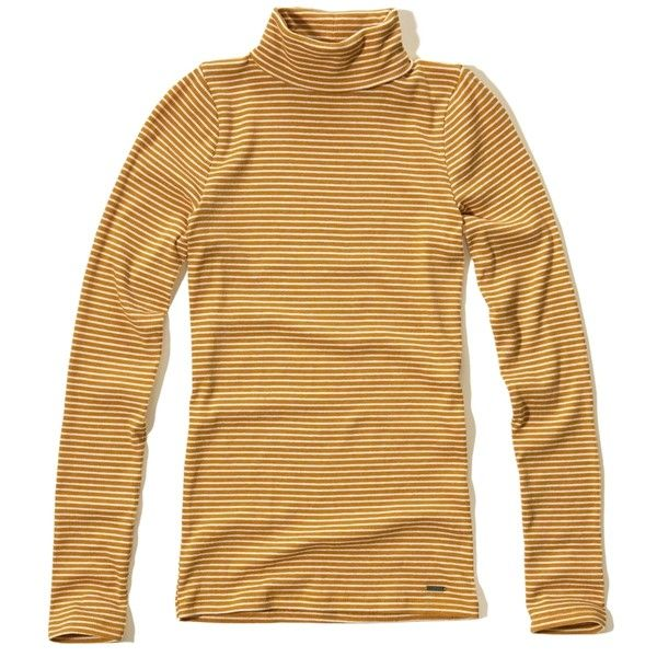 Hollister Must-Have Turtleneck T-Shirt ($17) ❤ liked on Polyvore featuring tops, t-shirts, dark yellow stripe, long sleeve t shirts, brown long sleeve t shirt, brown turtleneck, ribbed turtleneck and logo t shirts