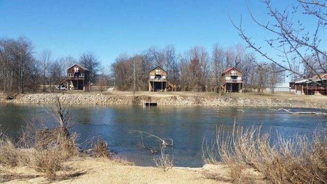 Waterfront lot on lower Current River in southeast Missouri Ozarks-fishing, swimming,camping, picnic area,boating, canoeing and water sports is what you get with this partially treed river lot. There is also more lots for sale if someone wants to expand and as a plus each lot owner has access to a common ground too. Call For Details!!! in  Doniphan MO