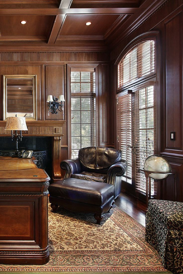 Guest Area Of Elegant Home Office With Large Area Rug And Coffered Wood  Ceiling.