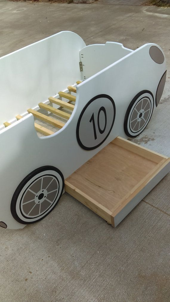 The bed shown is a toddler race car bed and is fun fun fun for the little ones:) You will enjoy the craftsmanship with easy set up. Comes