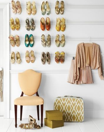 Display Them: Don't have a place to put certain items? Try to display them in an artful way and make them look like part of the decor. Source: Martha Stewart
