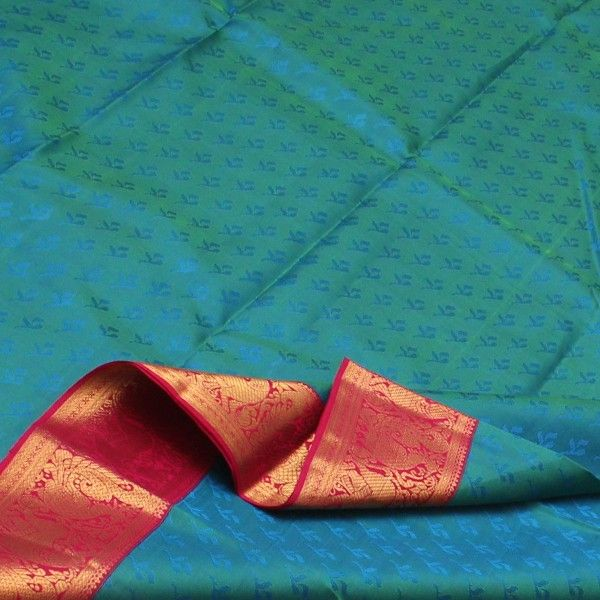 Azure leaf motifs seem to float lazily on aquamarine waters, almost creating a peacock blue wonder. The soothing colours of the #silk body contrasts with the majestic rani pink and gold border, as proud peacocks and yaalis strut around. Paisleys, stripes and deepam motifs in gold set the rani pink pallu on fire to create a gorgeous addition to your collection. For such beautiful blues, visit #Sarangi. Code 020126189.