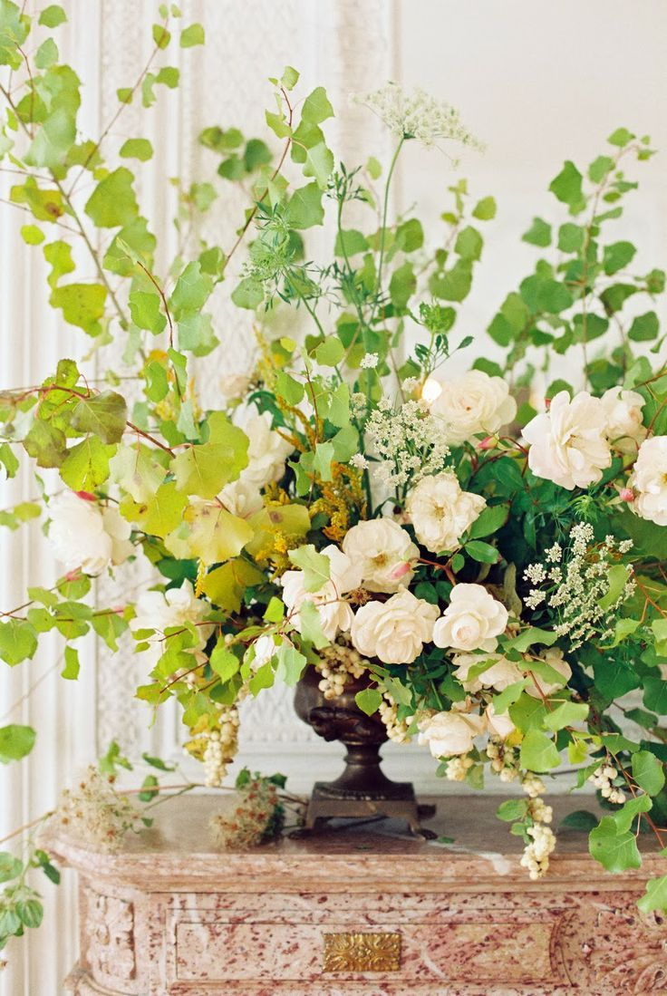 Wild autumn arrangement of foraged fall leaves and roses