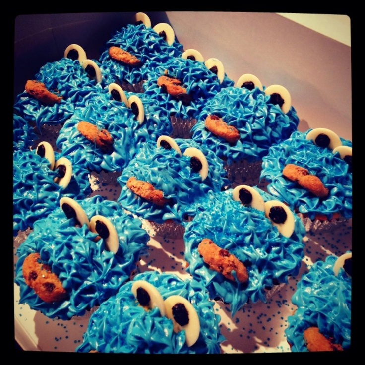 Cookie Monster Cupcakes-Funfetti cupcakes topped with cotton candy frosting and …