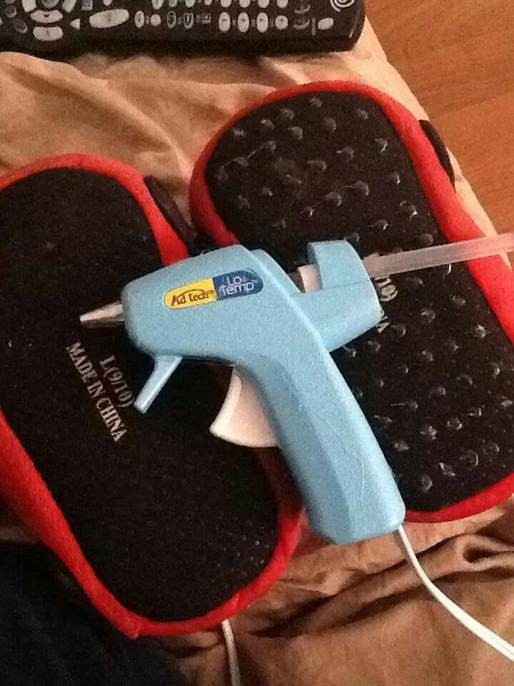 Use your hot glue gun to make slippers into non slip shoes ...