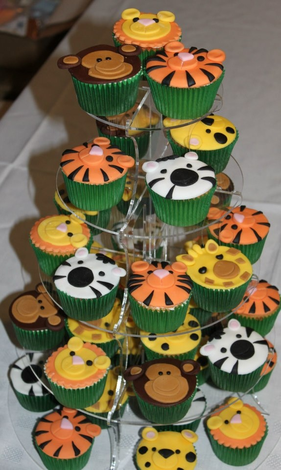 Jungle animal cupcakes.  This looks super easy with fondant and the right cutters.